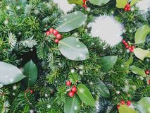 Christmas crowns composition. Top view of pine and bay tree branches - Vintage retro Christmas concept with round space for