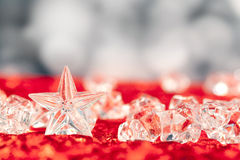 Christmas crystal star on ice cubes Stock Image