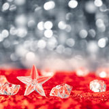 Christmas crystal star on ice cubes Stock Photo