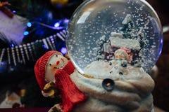 Christmas crystalball. Shiny christmass crystalball behind Christmas tree Royalty Free Stock Photography