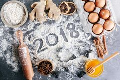 Christmas culinary background. Ingredients for baking. Ginger, honey, cinnamon, flour, eggs. View from above Royalty Free Stock Photos