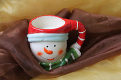 Christmas cup. Of a snowman with milk Royalty Free Stock Image