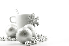 Christmas cup. Christmas ball and cup on the white background Stock Photos