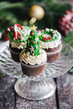 Christmas cup cakes served Stock Photo