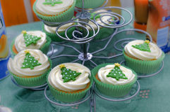 Christmas cup cakes on stand Stock Photos