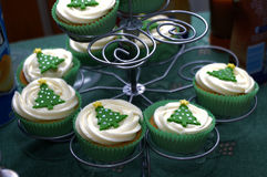 Christmas cup cakes on stand. Christmas cup cakes on spiral shaped metal stand Royalty Free Stock Photography