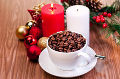 Christmas cup of coffee beans on wooden table Royalty Free Stock Photography