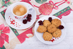 Christmas cup of coffee and cookies on a festive tablecloth Stock Photography