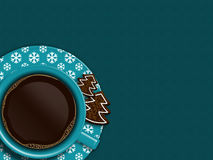 Christmas cup of coffee and cookies lying on blue tablecloth Royalty Free Stock Images