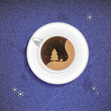 Christmas Cup of coffee on a jeans background Royalty Free Stock Images