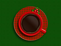 Christmas cup of coffee lying on green tablecloth Royalty Free Stock Images