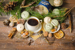 Christmas A Cup of Coffee with Macaroons. Christmas and New Year A Cup of Coffee with Macaroons, Vintage Alarm Clock, Pine Branches, Antique Glasses, Walnuts Stock Photos