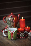 Christmas cup and decorations on wooden table. Christmas cup, red candles and decorations on wooden table Stock Photography
