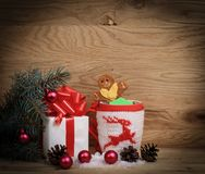 Christmas Cup,gingerbread house and a box of gifts. Photo with space for text Stock Images