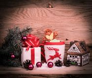 Christmas Cup,gingerbread house and a box of gifts. Photo with space for text Stock Photography