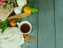 Christmas cup of tea with cookies, gifts, candles and mandarins Royalty Free Stock Photography