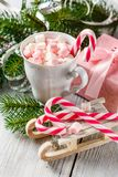 Christmas Cup With Small Marshmallows And Candy Canes Royalty Free Stock Images