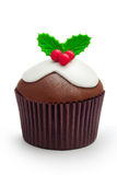 Christmas cupcake. Christmas pudding cupcake against white royalty free stock photo
