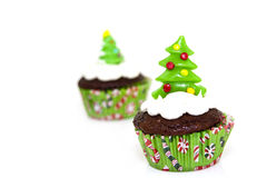 Christmas cupcake. Sweet christmas cupcake decorating with icing , sprinkles and candy on a white background stock photography