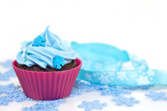 Christmas cupcake. Sweet christmas cupcake decorating with icing , sprinkles and candy on a white background royalty free stock images