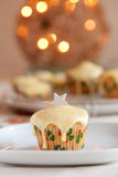 Christmas cupcake. Delicious christmas cupcake with christmas lights in background royalty free stock photo