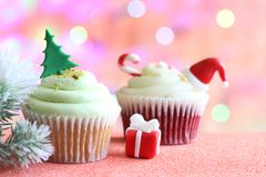 Christmas cupcake abstract ornament baking concept on defocused colorful background royalty free stock photos