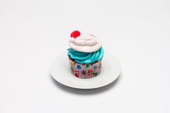 Christmas cupcake with butter cream icing. Stock Photos