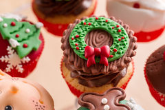 Christmas cupcake. With chocolate cream and decorative symbol stock images