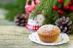 Christmas cupcake on the Christmas table. Shallow DOF stock images