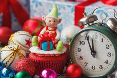 Christmas cupcake with colored decorations, soft focus background. Christmas cupcake with colored decorations Elf made from confectionery mastic, soft focus Royalty Free Stock Image