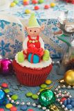 Christmas cupcake with colored decorations. Made from confectionery mastic, soft focus background royalty free stock images