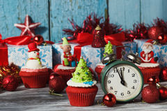 Christmas cupcake with colored decorations. Christmas tree made from confectionery mastic, soft focus background royalty free stock photos