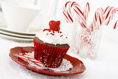 Christmas cupcake. Christmas decorated chocolate cupcake with vanilla frosting and candy canes stock images