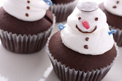Christmas cupcake. Decorated with a whipped cream snowman stock photos