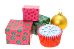 Christmas cupcake and gift boxes Stock Photography