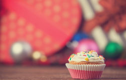 Christmas cupcake. And gifts on background stock photo