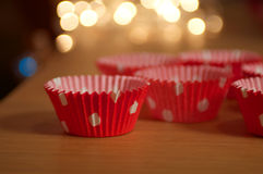 Christmas Cupcake Holders. With twinkly fairy lights in the background Royalty Free Stock Image