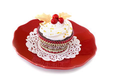Christmas cupcake with Holly Stock Images