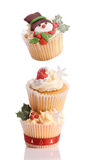 Christmas Cupcake Tower. With top cake decorated with a snowman, all on white background stock photo