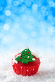 Christmas cupcake. With Christmas tree symbol on top royalty free stock image
