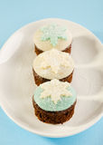 Christmas cupcake with white and blue snow flake decoration. on Stock Photos