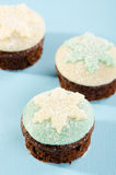 Christmas cupcake with white and blue snow flake Stock Photos