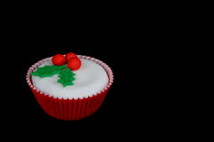 Christmas cupcake with white fondant frosting royalty free stock image