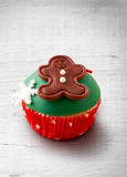 Christmas cupcake on a wood table Stock Image