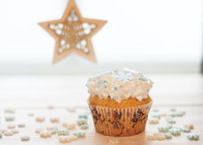 Christmas cupcake. On a wooden table stock photography
