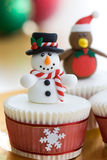 Christmas cupcakes. Decorated with a snowman and robin Royalty Free Stock Photography