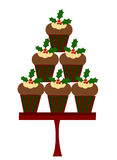 Christmas cupcakes. With holly berry leaves Stock Image