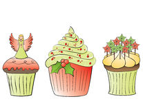 Christmas cupcakes. 3 cupcakes with christmas decorations Royalty Free Stock Photos