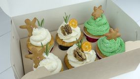 Christmas cupcakes in a box on the table royalty free stock photography