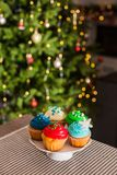 Christmas cupcakes on the cakestand on the table stock photos